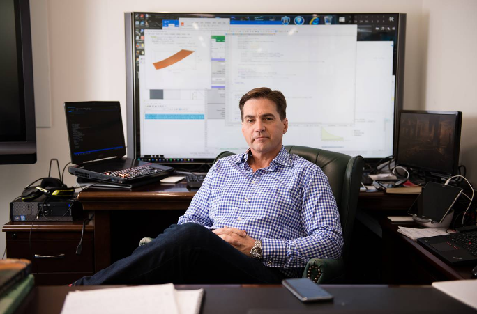 Craig Wright in a chair